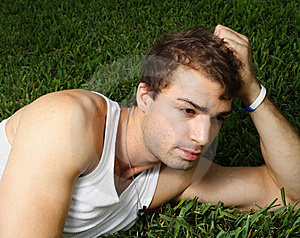 Young Man Laying On The Grass Royalty Free Stock Image - Image: 6250166