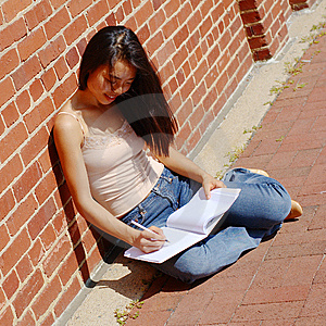 Girl Writing In Note Book Royalty Free Stock Photo - Image: 6253545