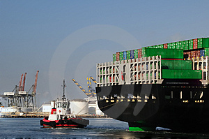 Tugboat And Back Of Container Ship Royalty Free Stock Image - Image: 6254766