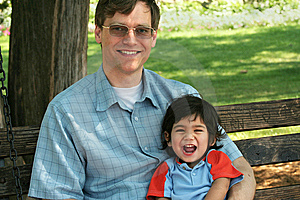 Father And Son Enjoying Swinging In The Park Stock Photos - Image: 6255633