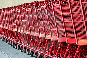 Row Of Red Metal Shopping Carts Royalty Free Stock Image - Image: 6268796