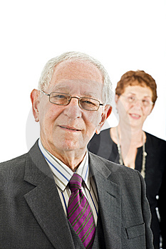 Senior businessman with colleague Stock Photography
