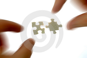 Hands and puzzle pieces Stock Photography