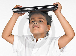 Boy holding laptop on his head Stock Photos