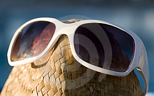 A Straw Hat With Sun Glasses Sitting Beside Pool Royalty Free Stock Images - Image: 6329259