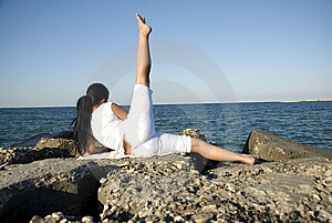 Back of woman doing sport at sea Stock Photos