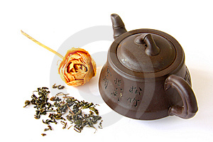 Chinese Clay Teapot With Tea Leaves And Rose Royalty Free Stock Photos - Image: 6361828