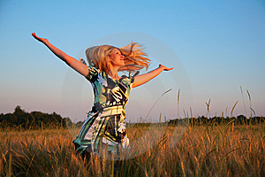 Girl With Lifted Hands And Flying Hair On Wheaten Royalty Free Stock Image - Image: 6374676