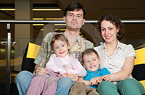 Family Sit On Sofa In Dark Hall Royalty Free Stock Photography - Image: 6374777