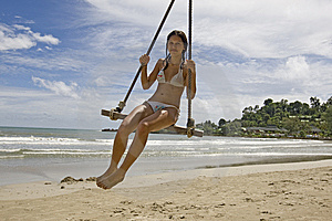 Girl On Swing On The Beach Royalty Free Stock Photos - Image: 6400458