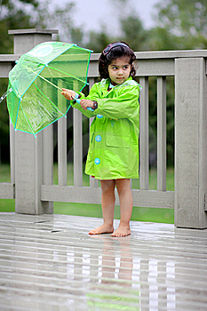Child and her rain gears Royalty Free Stock Photo