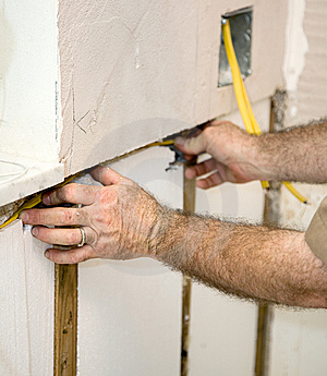Electrician Wiring The Walls Stock Image
