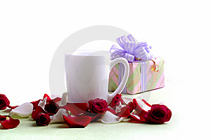 White Cup And Rose Petals And Heads Royalty Free Stock Photography - Image: 6435237
