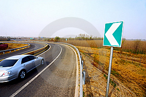 Car In A Curve Royalty Free Stock Photo - Image: 6444625