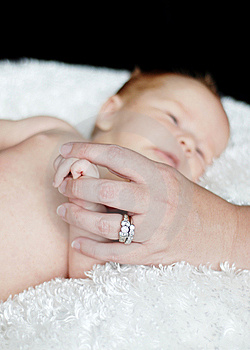 Mother Holding Baby's Hand Free Stock Image