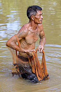Fisherman Of Thailand With Throw Net Stock Photo - Image: 6454320