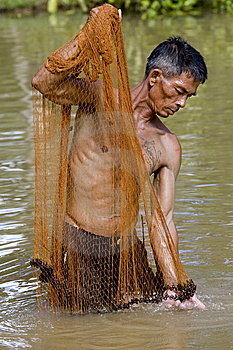 Fisherman Of Thailand With Throw Net Royalty Free Stock Image - Image: 6454326