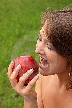 Girl Biting Apple Stock Photo - Image: 6461590