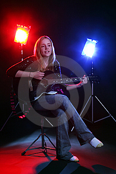 Woman On Stage With Red And Blue Concert Lights Royalty Free Stock Photo - Image: 6470375