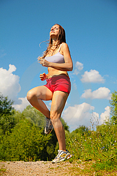 Girl running forest Stock Photography
