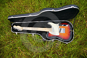 Guitar In Case On Grass Royalty Free Stock Photos - Image: 6480398
