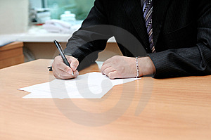 Signing the document Stock Images