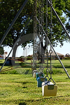 Lonely Row Of Swings Stock Images - Image: 6492414
