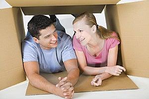 Couple lying in box