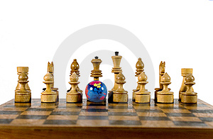 Globe And Wooden Chess Figures Royalty Free Stock Images - Image: 6509909