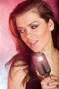 Girl singing in retro mic Royalty Free Stock Photo