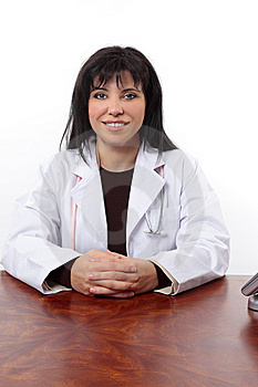 Smiling Doctor Sitting At Desk Royalty Free Stock Photography - Image: 6514607
