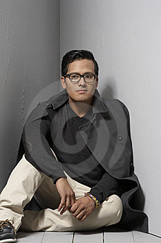 Sitting On A Gray Floor Stock Images - Image: 6535694