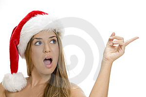 Indicating sexy lady with santa cap Royalty Free Stock Images