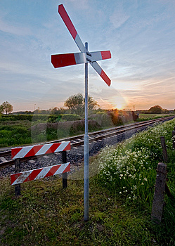 Railway Tracks With Pastel Sunset And Traffic Sign Royalty Free Stock Photo - Image: 6540045