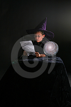 Wizard Child Reading A Spell Stock Photos - Image: 6541203