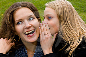 Two happy young girlfriends talking Royalty Free Stock Images