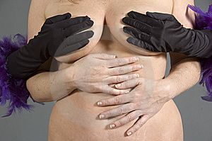Woman holding another woman's breasts Royalty Free Stock Photo