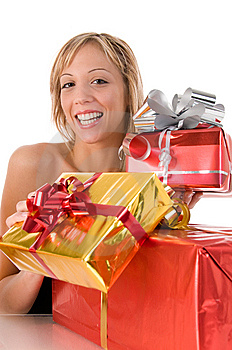 Young Woman Offers Xmas Gifts Stock Image - Image: 6584901