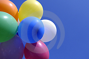 Colorful floating balloons Stock Photos