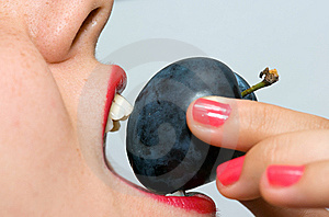 Girl Eating A Plum Closeup 4 Royalty Free Stock Photos - Image: 6597258