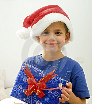Boy And Presents Royalty Free Stock Image - Image: 6600626