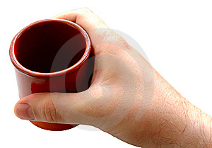 Pottery Cup In Man's Hand. Royalty Free Stock Photography - Image: 6604507
