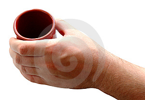 Pottery Cup In Man's Hand. Royalty Free Stock Images - Image: 6604529