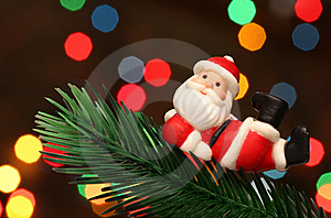 Santa Resting Over A Christmas Branch Tree Stock Photo - Image: 6611100