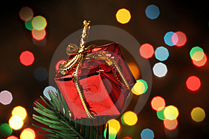 Gift Box Over A Christmas Branch Tree Stock Image - Image: 6611191