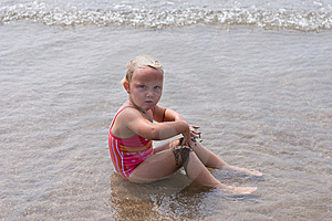 Girl Playing At The Beach Stock Photos - Image: 6615353
