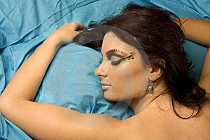 Woman Sleeping In Blue Bedclothes Stock Photo - Image: 6615860