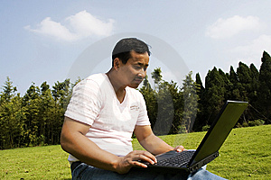 Man Using A Laptop Outdoors Stock Photography - Image: 6617772