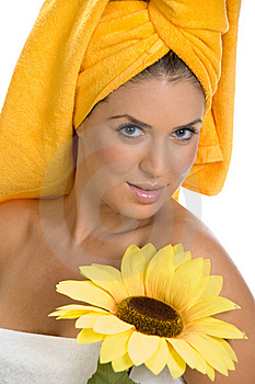 Posing Smiling Sexy Female In Towel With Sunflower Stock Image - Image: 6617971