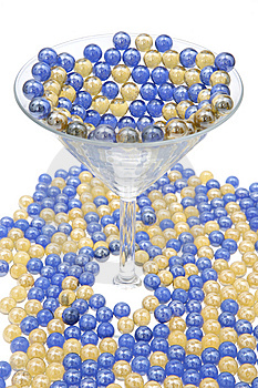 Blue And Gold Marbles Resting In A Martini Glass. Royalty Free Stock Photos - Image: 6626408